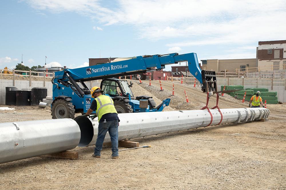 Local 96 Assembling Musco light poles